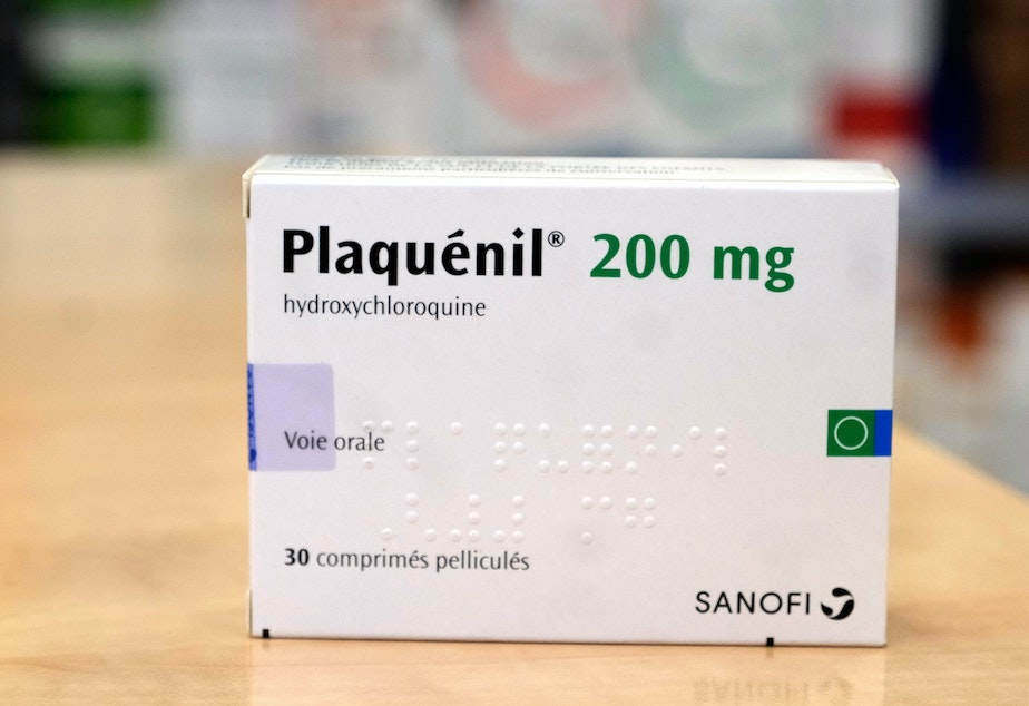 caption: A pack of Plaquenil, (Hydrochloroquine) is displayed in a Parisian pharmacy on Tuesday in Paris, France. Chloroquine or Hydroxychloroquine, is now one treatments being evaluated in clinical trials as a possible preventative or treatment for COVID-19.