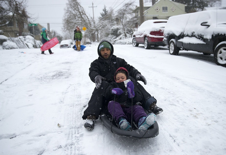 Bryan Baker sleds with his 5-year-old daughter Avery Baker on Monday, February 4, 2019, next to the West Queen Anne playfield at the intersection of 3rd Avenue West and West Howe Street in Seattle.