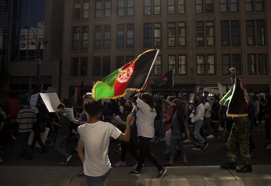 caption: About 100 people attended a rally and march organized by Afghans of Seattle, a new organization composed of young Afghan-Americans in the greater Seattle area, to stand in solidarity with Afghans on Saturday, August 28, 2021, at Westlake Park in Seattle.