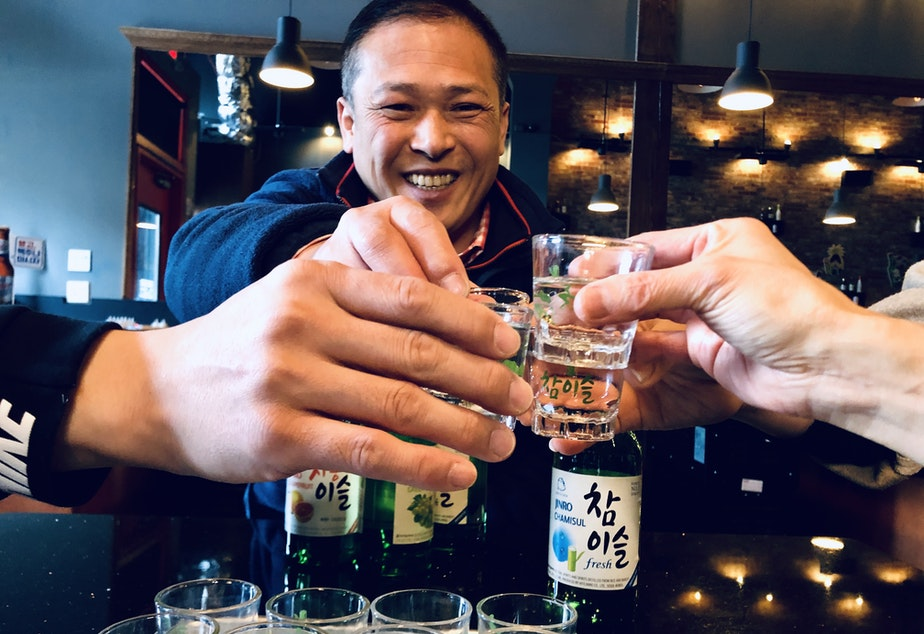 caption: Dan Cho of Coho Imports supports a bill that would allow Korean restaurants to serve soju by the bottle at the table. State law requires distilled spirits to be served by the shot glass only.