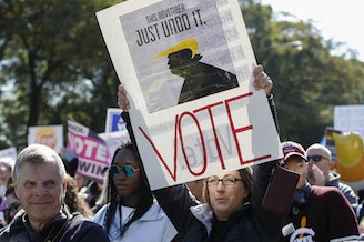 Women gather for a rally and march at Grant Park on Saturday in Chicago to urge voter turnout ahead of the midterm elections. CREDIT: KAMIL KRZACZYNSKI