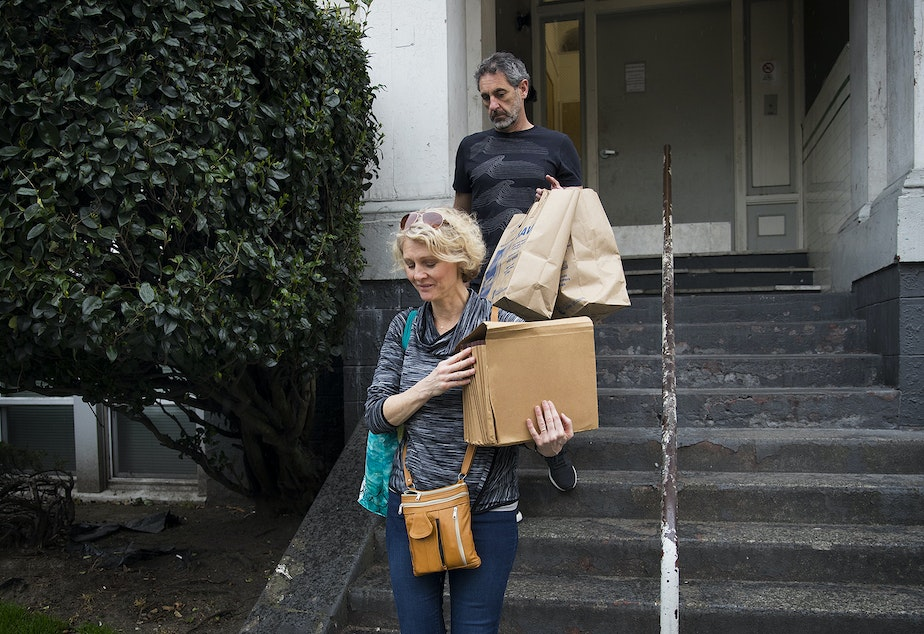 Jerri and Matt Clark carry the last of their son Calvin's belongings out of his apartment building on Friday, March 22, 2019, in Seattle.