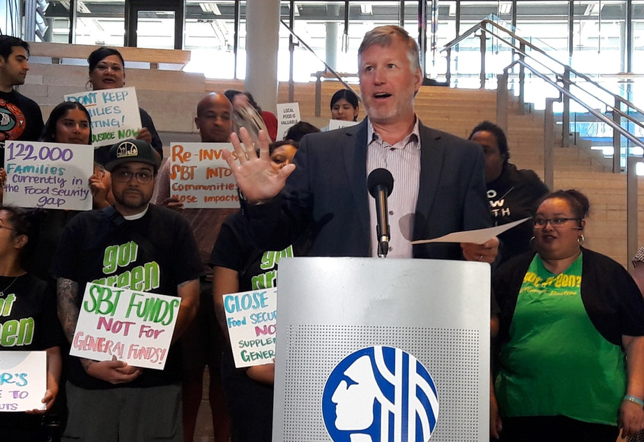caption: Seattle Councilmember Mike O'Brien said his bill ensures that soda tax revenue will be used for programs helping low income families disproportionately affected by the surcharge.