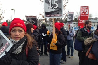 FILE: Fast-food workers and minimum wage advocates marched from SeaTac to Seattle in December  2013 as part of a national demonstration for a $15 minimum wage.