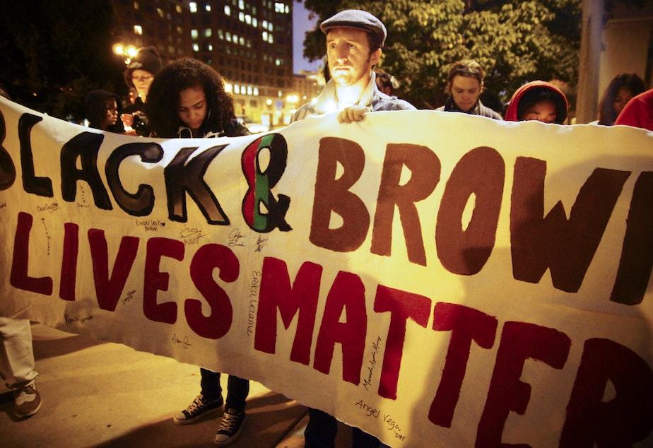 People take part in a 'Black Lives Matter' demonstration.