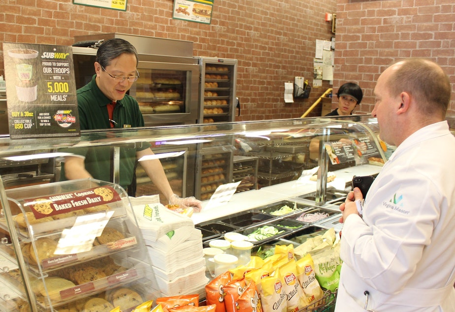 caption: Joseph Cheng owns two Subway shops in Seattle's First Hill neighborhood. He says Seattle's new minimum wage law shouldn't treat him like a big business.