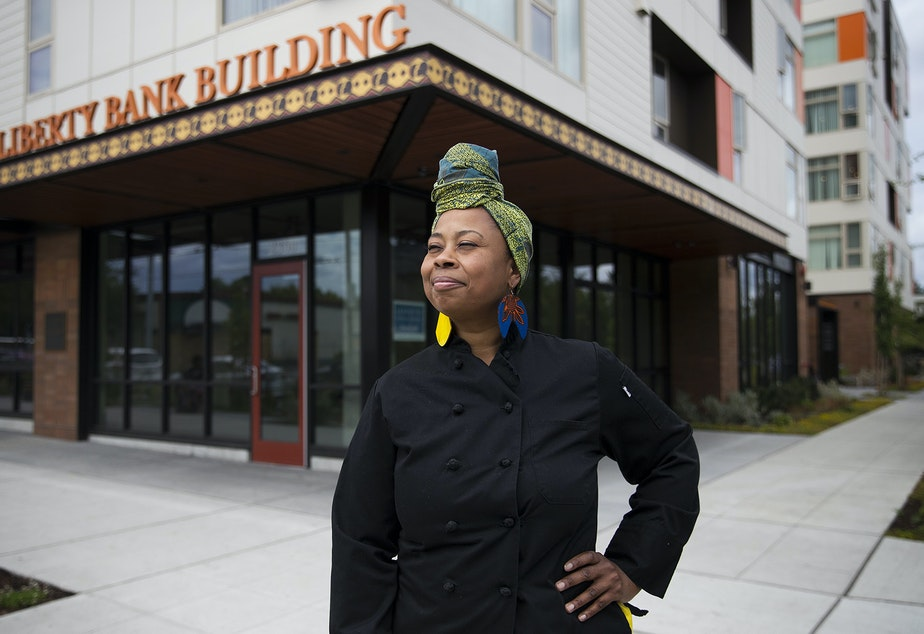 caption: Chef Kristi Brown poses for a portrait outside of the Liberty Bank Building at the intersection of 24th Avenue and East Union Street on Thursday, July 11, 2019, in Seattle.