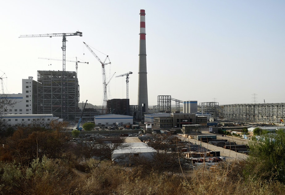 caption: A Chinese-backed power plant under construction in 2018 in the desert in the Tharparkar district of Pakistan's southern Sindh province.