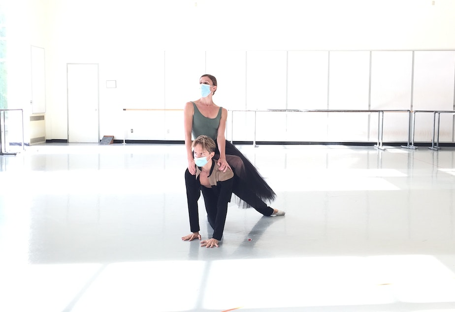 caption: PNB soloists Elle Macy and Dylan Wald in the studio. The couple are among the few dancers allowed to touch one another because they are offstage domestic partners