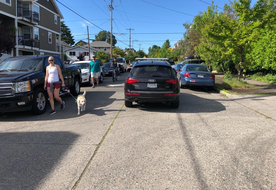 caption: While signs discourage through traffic, cars can still access these closed streets, such as this one on 17th Avenue NW in Ballard.