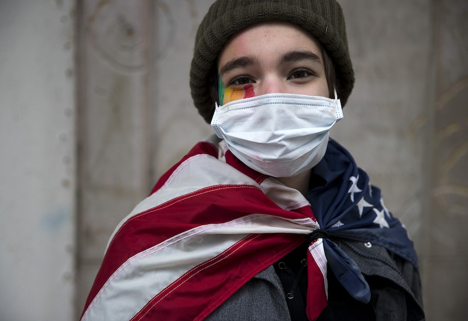 "caption: Chloe Fierstein, 14, stands for a portrait while walking to the 'Our Work Continues: Protect Every Person' event, shortly after Joe Biden was officially named president-elect on Saturday, November 7, 2020, at the intersection of 10th Avenue and East Pine Street in Seattle. ""Today means a lot to me,"" said Chloe. ""We can change the harsh ways that America is right now."""