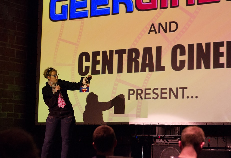 "caption: GeekGirlCon programming director Jennifer K. Stuller kicks-off a viewing of ""Supergirl"" at a 2013 event at Central Cinema."