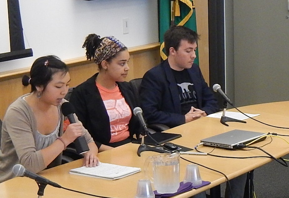 Student activists Angela Feng, Sarra Tekola and Alex Lenferna of Divest UW appear before the UW Board of Regents on Thursday to urge the university to get rid of its coal investments..