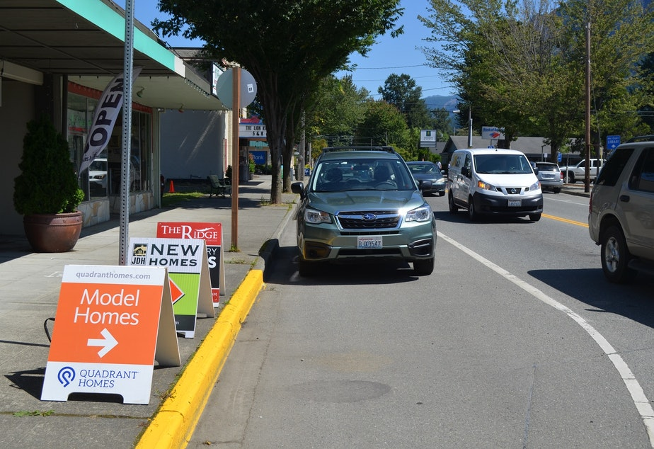 Home sales signs in North Bend, Washington, due east of Seattle. The tiny town is experiencing a population boom, which is tapping its water resources.