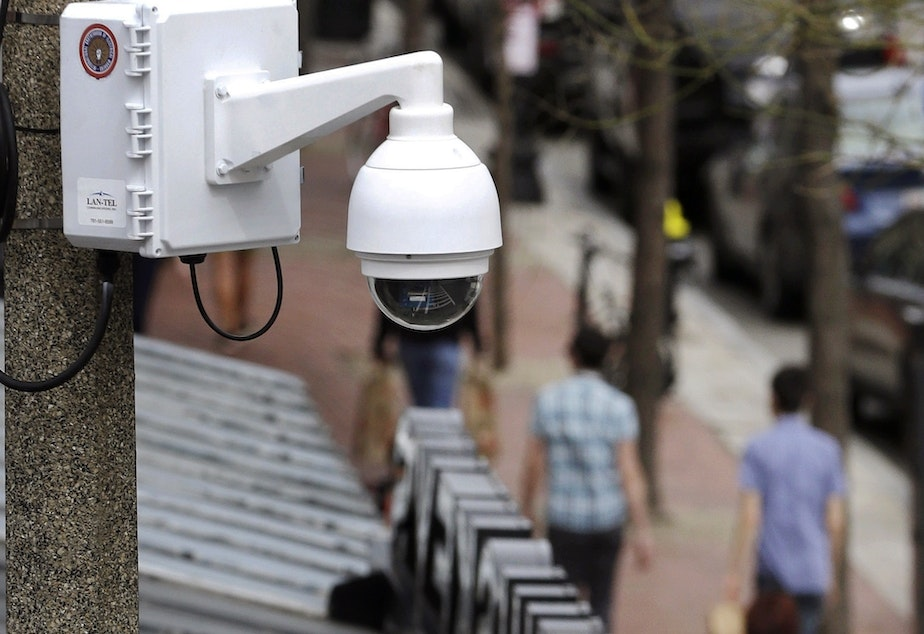 caption: Surveillance cameras, like the one here in Boston, are used throughout Massachusetts. The state now regulates how police use facial recognition technology.