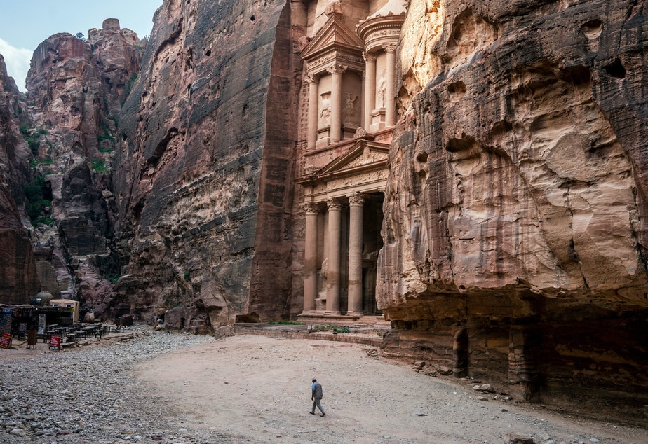caption: Tour guide Mohammad Awwad by the Treasury in Petra, Jordan's biggest tourist destination.