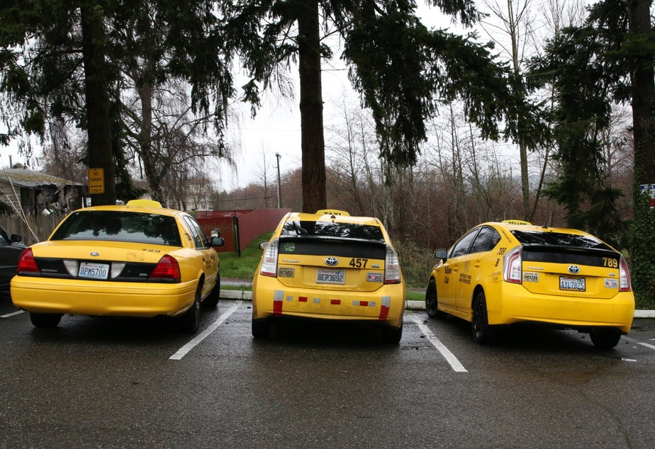 caption: Taxicabs at the Seattle Yellow Cab offices in Tukwila