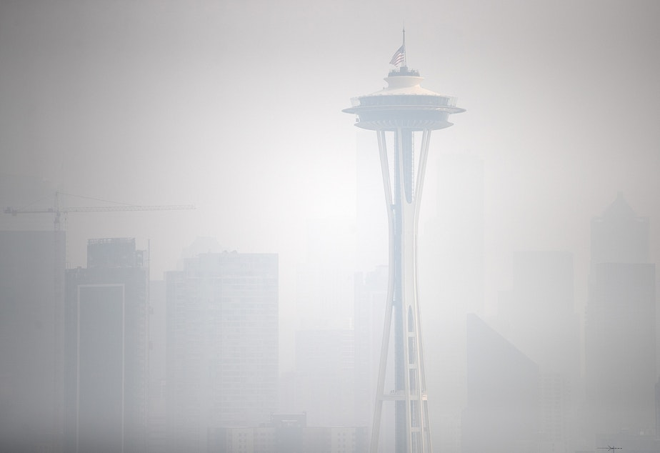 caption: The Space Needle, shown from Kerry Park, is shrouded in a massive plume of smoke from wildfires burning in California and Oregon on Friday, September 11, 2020, in Seattle.