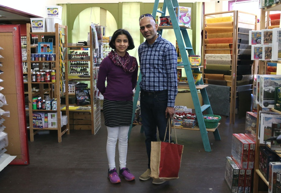 caption: Ram Almeida and Sophia Almeida removed their masks for a portrait in Tri-Dee Arts of Mount Vernon, where they shopped after visiting the tulip fields.