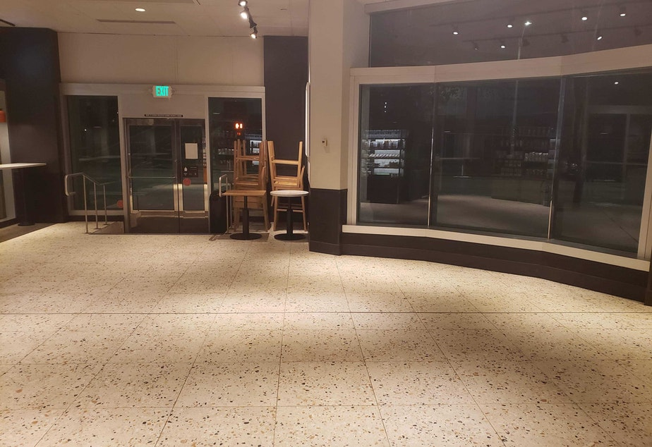 caption: The Starbucks at 2nd Avenue and Seneca Street, March 16, 2020. The first weekday after Gov. Jay Inslee ordered no public gatherings more than 50 people, and shut down restaurants and bars statewide. Starbucks also recently announced that it was halting in-person service and only doing to-go service.
