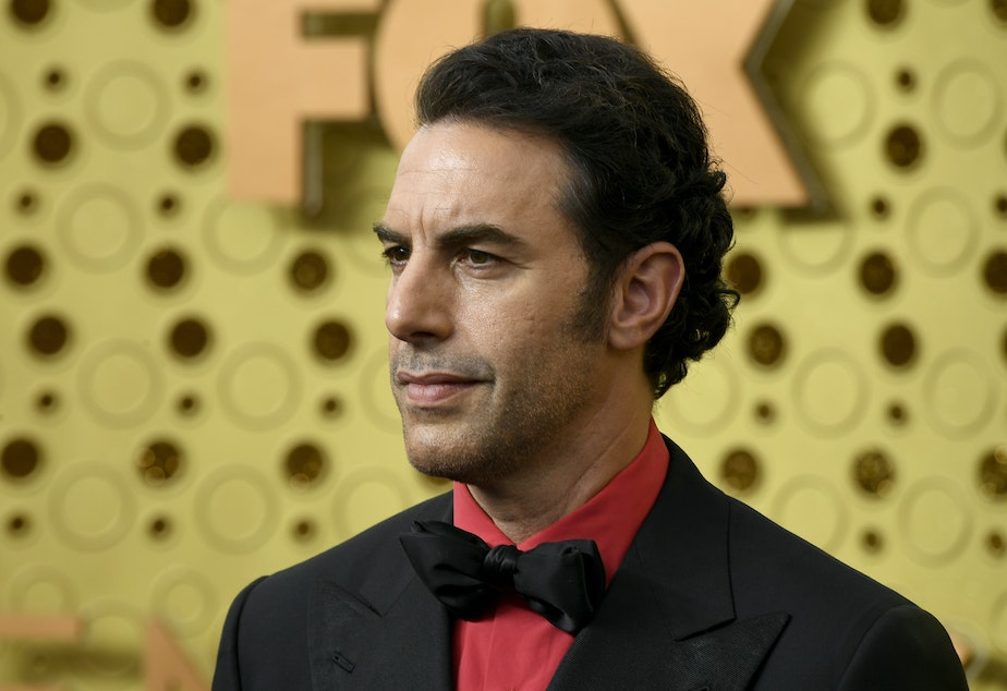 caption: Sacha Baron Cohen, pictured at the Emmy Awards in 2019, is suspected of being behind a prank on a far-right group.