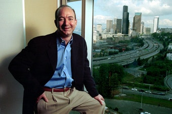 FILE: Jeff Bezos, founder and CEO of Amazon.com, is shown at the online retail company's then-offices overlooking the Seattle skyline on May 2, 2001. The original caption reads, 'Despite company layoffs and a bruising stock plunge, Bezos says he believes in Amazon more than ever.'