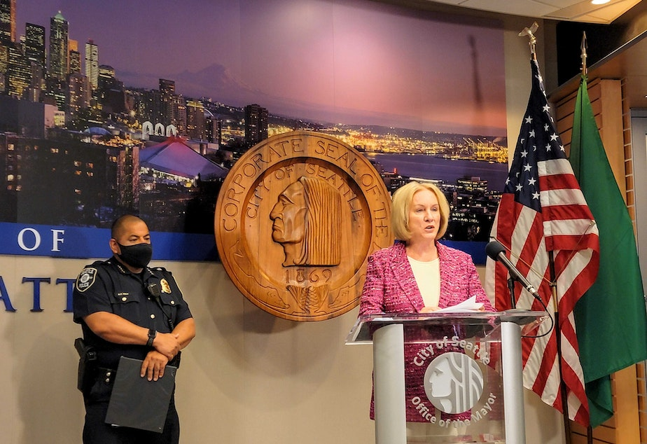 caption: Mayor Durkan and Chief Diaz respond to reporters after a weekend of fatal shootings on Monday, July 26, 2021.