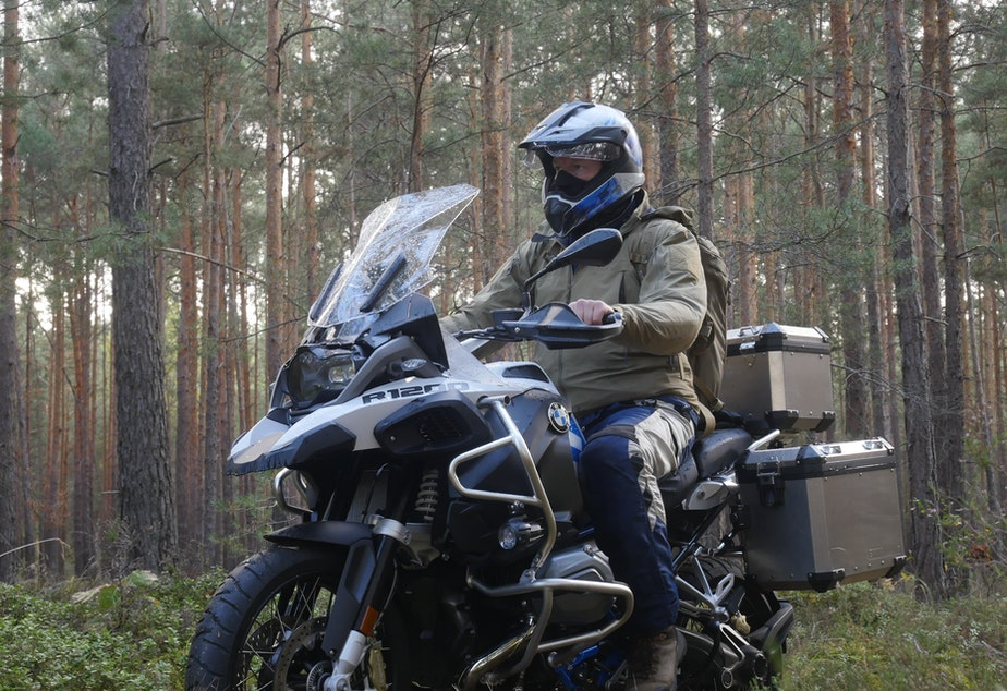 caption: Chris Morgan rode his motorcycle from Poland into Germany following the path of the wolves.