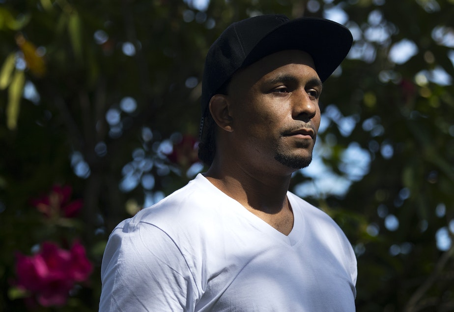 """caption: """"We were scared to death in there,"""" said Wesley Mitchell. Here, Mitchell stands for a portrait on Sunday, May 10, 2020, in Seattle. """"I'm a non-violent offender with a drug charge,"""" said  Mitchell. """"I've got health issues; I've got asthma – it could easily be a death sentence for me if I were to catch it."""""""