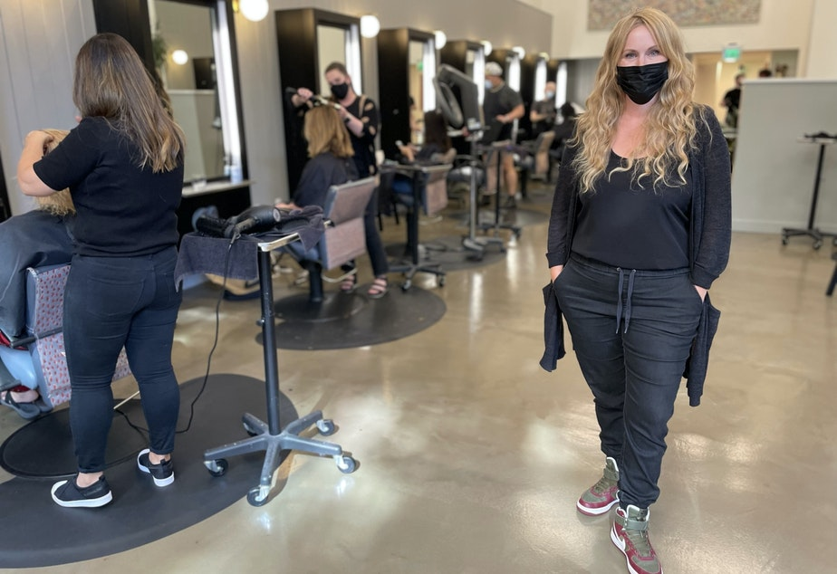 caption: Becca Stordahl, one of the owners of Robert Leonard Salon across the street from Amazon's HQ