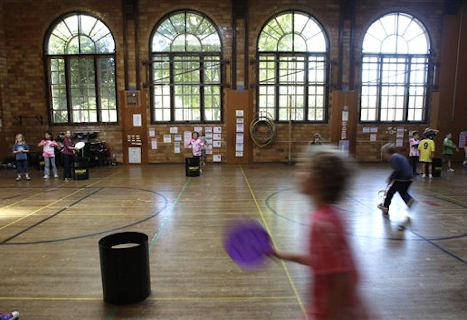 caption: Students in a PE class at Salmon Bay K-8 School in Seattle. KUOW has learned that the Washington state schools office in Olympia has signed agreements to share non-public student data with media organizations.