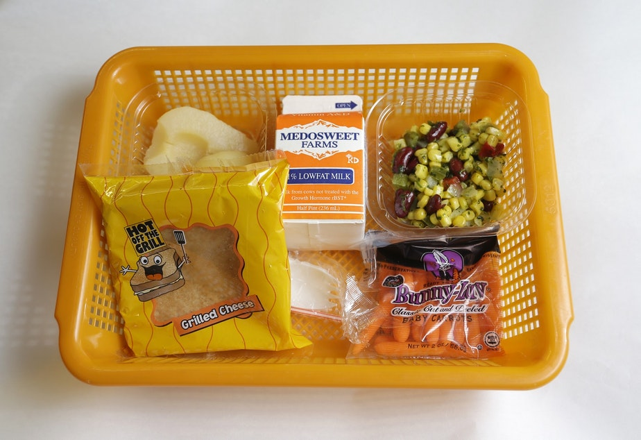 caption: A school lunch featuring a grilled cheese sandwich on whole grain bread served with a southwestern-style corn salad, fresh carrots and either canned pears or apple sauce is shown Monday, May 5, 2014, at Mirror Lake Elementary School in Federal Way, Wash., south of Seattle.