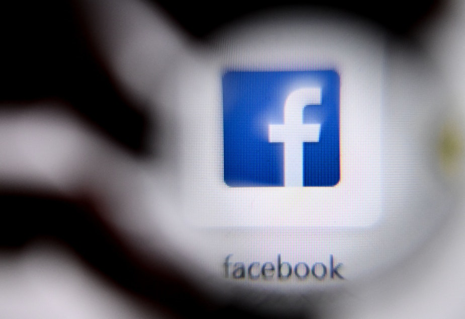 caption: The U.S. online social media and social networking service Facebook's logo is shown on a laptop screen. Facebook has announced changes to its policies on online bullying.