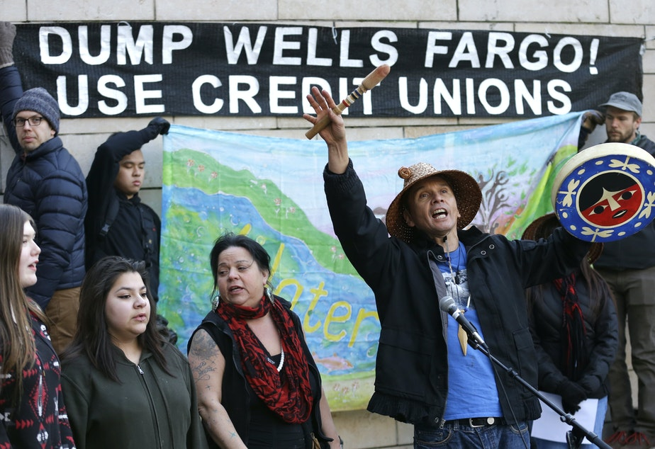 Paul Wagner, center, of the Saanich Nation on Vancouver Island, takes part in a protest against the Dakota Access Pipeline and the City of Seattle's use of Wells Fargo Bank, Wednesday, Feb. 1, 2017, at City Hall in Seattle.