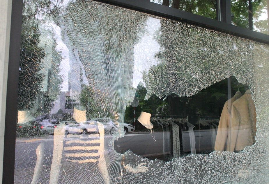 caption: A smashed window at Smith & Main, a business in downtown Bellevue on Sunday, May 31, 2020.