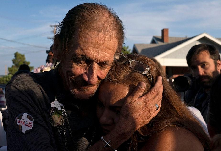 Antonio Basco, husband of El Paso Walmart shooting victim Margie Reckard, hugs an attendee during his wife's visitation service in El Paso, Texas, in August.