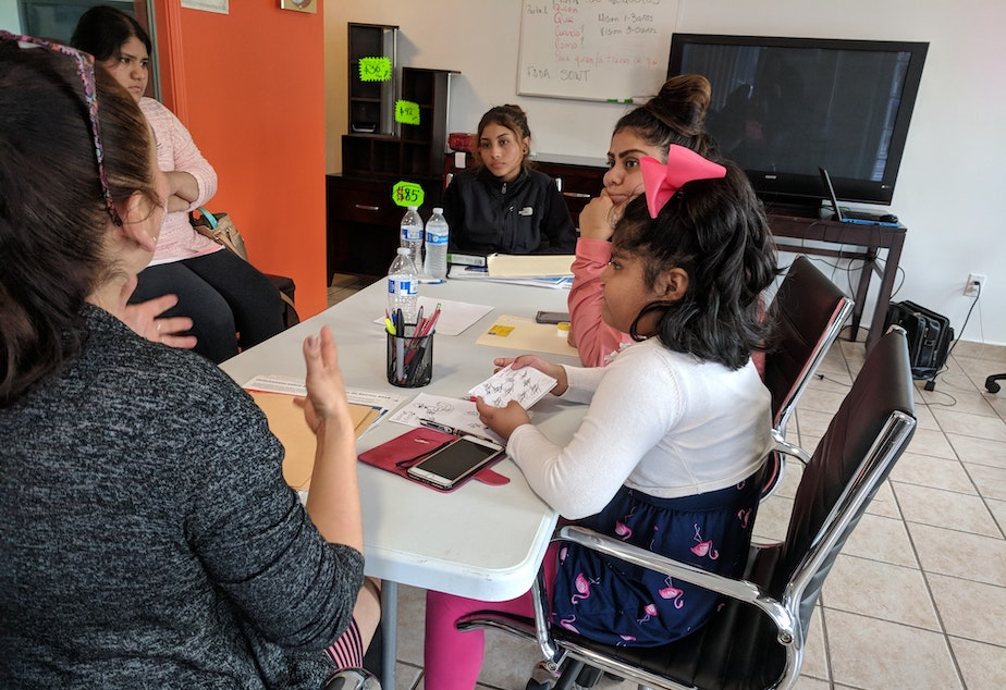 caption: Rocio Arriaga teaches kids and young people about business to try and mitigate the impacts of gentrification.