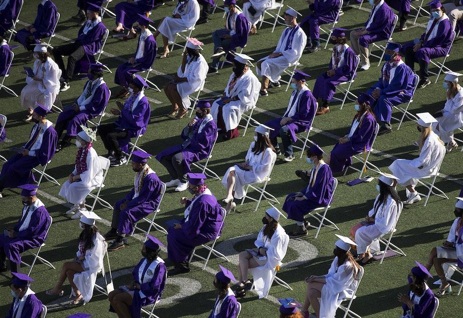 caption: Garfield High School seniors graduate in-person on Tuesday, June 15, 2021, at Memorial Stadium in Seattle.
