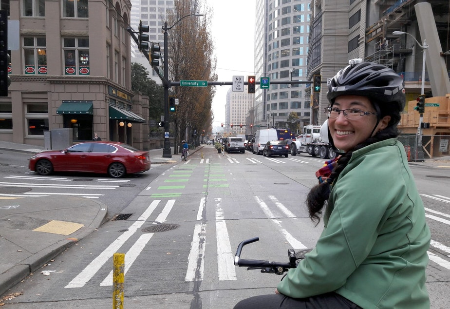 caption: Clara Cantor, of Seattle Neighborhood Greenways, on downtown Seattle's 2nd Avenue protected bike lane.