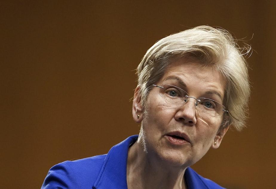 caption: Sen. Elizabeth Warren speaks during a Senate Finance Committee hearing in Washington on Feb. 24. Warren's latest book is called <em>Persist</em>.