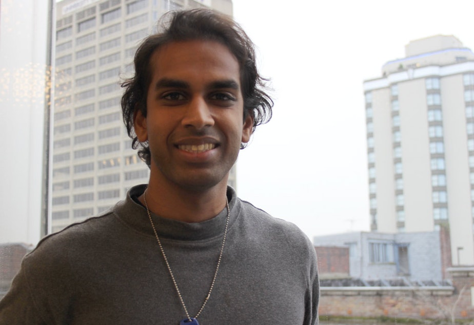 caption: Jonathan Kumar, founder of the GiveSafe app, in the KUOW studios.