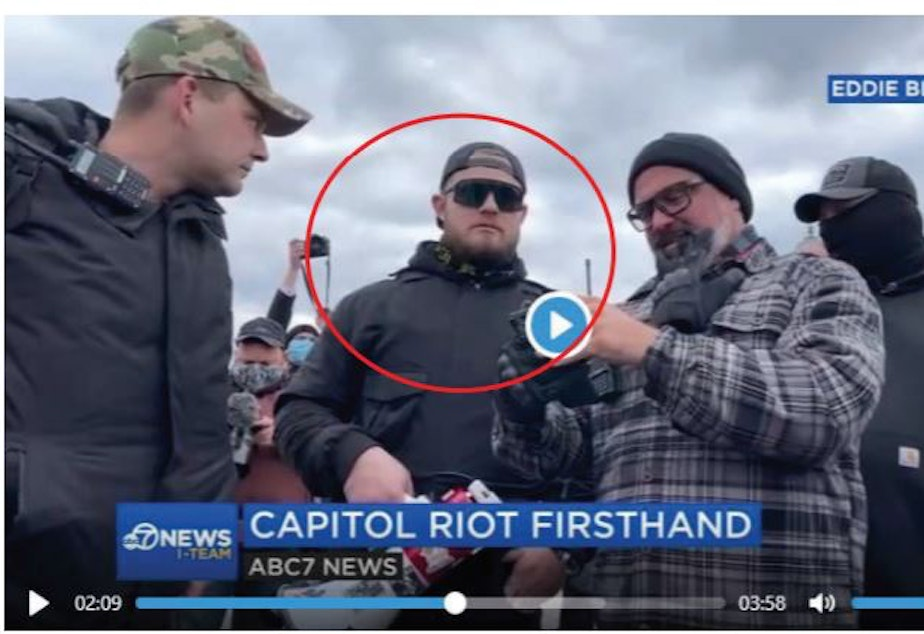 caption: Federal prosecutors say this image shows Ethan Nordean in a crowd of Proud Boys who participated in storming the U.S. Capitol on Jan. 6.