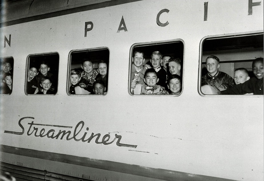 From 'Seattle on the Spot,' a book of photographs by Al Smith: This is the 'International Fighting Irish youth football team leaving Seattle to play a championship game in Las Vegas in 1954. (To help us ID these children, note the photo number. This is #7.)