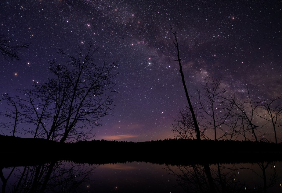 caption: A scenic view of a lake against the sky at night in British Columbia. Earlier this month, a resident of Golden, B.C., woke up to the sound of a crash and found that a meteorite had landed in her bed.
