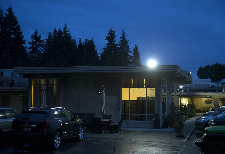 caption: Evening falls on the Life Care Center of Kirkland, the epicenter of the coronavirus outbreak in Washington state, on Thursday, March 5, 2020, in Kirkland.