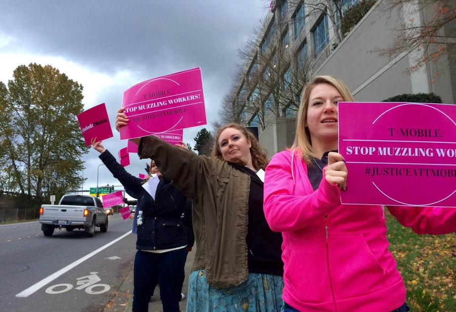 T-Mobile employees protest outside the company's headquarters in Bellevue.