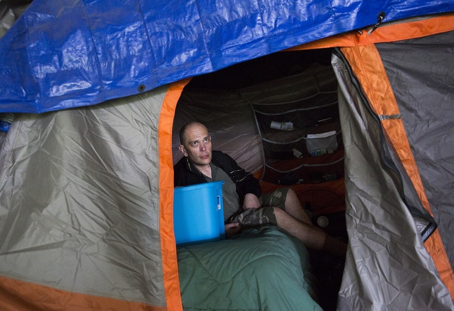 Kevin Boggs in his tent in the Jungle, before the tent encampment was torn down in 2016. Boggs was signed up at methadone clinics because of an addiction.