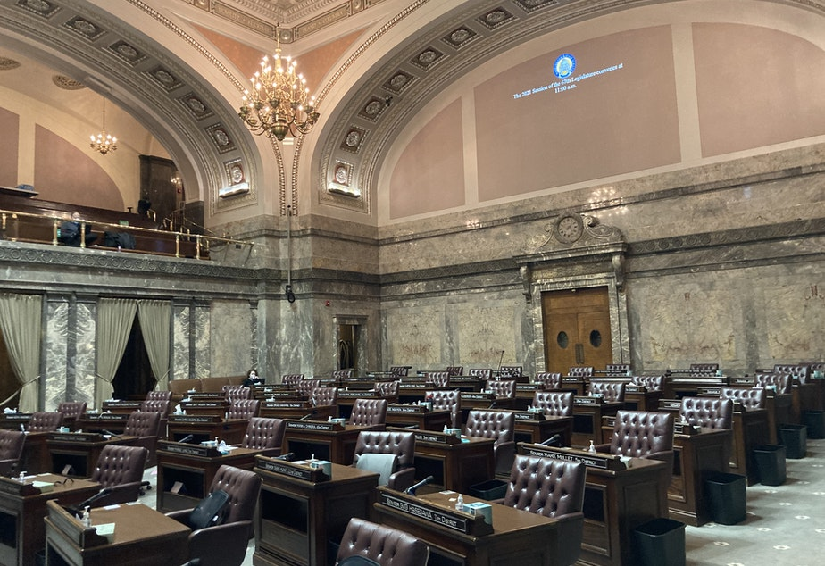 caption: The Washington Senate chamber sits empty before the start of the legislative session on January 11. Senate Democrats are taking the lead this year on a decade-long effort to pass a capital gains tax in Washington.