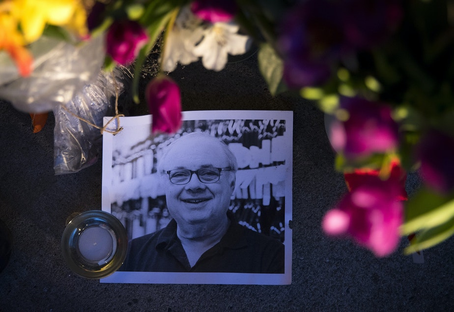 caption: Flowers, notes and pictures line the entrance of Leschi Market in memory of co-owner Steve Shulman on Monday, March 23, 2020, in Seattle. Shulman passed away on March 18 after testing positive for the coronavirus.