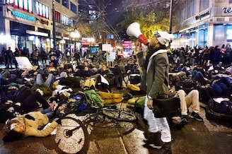 Protesters in response to the Ferguson and Eric Garner grand jury decisions converge on downtown Seattle on Dec. 4, 2014.